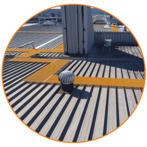 Fibre Reinforced Polyester (FRP) walkway system in yellow rovides a safe route for roof top workers