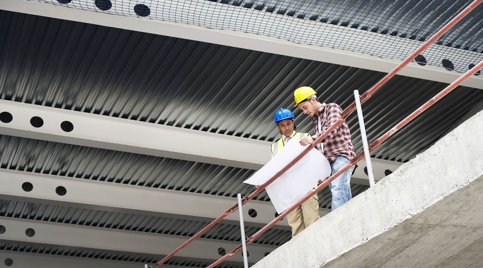 Construction workers looking at plan