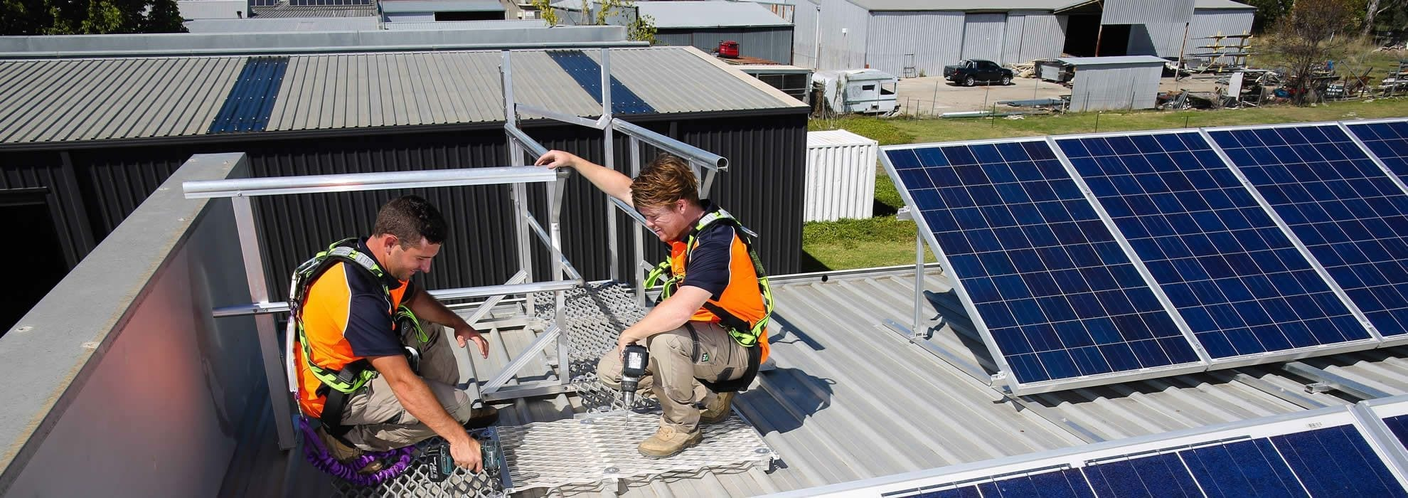 AnchorSafe employees on rooftop installing products