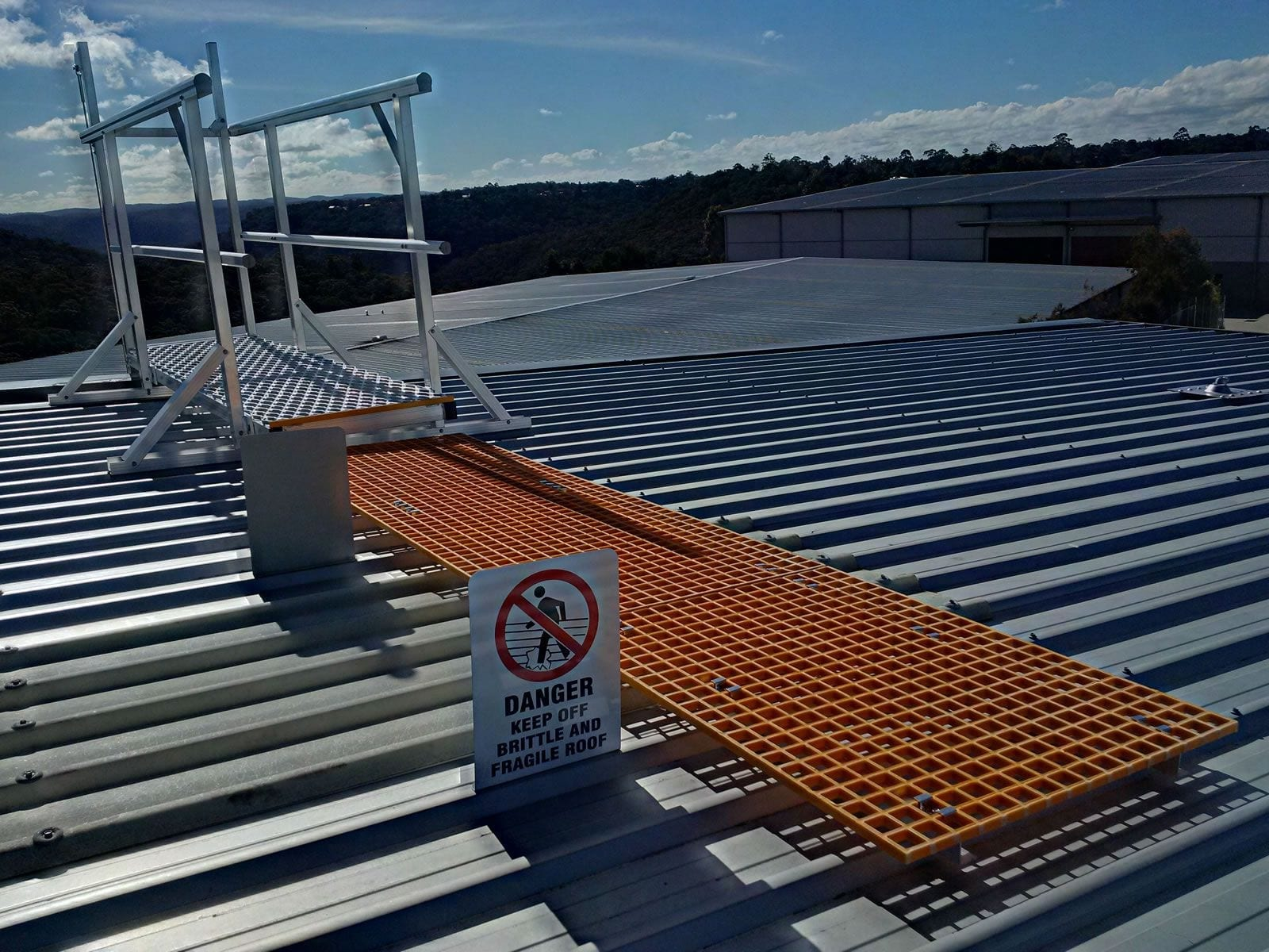 Rooftop walkway with safety sign