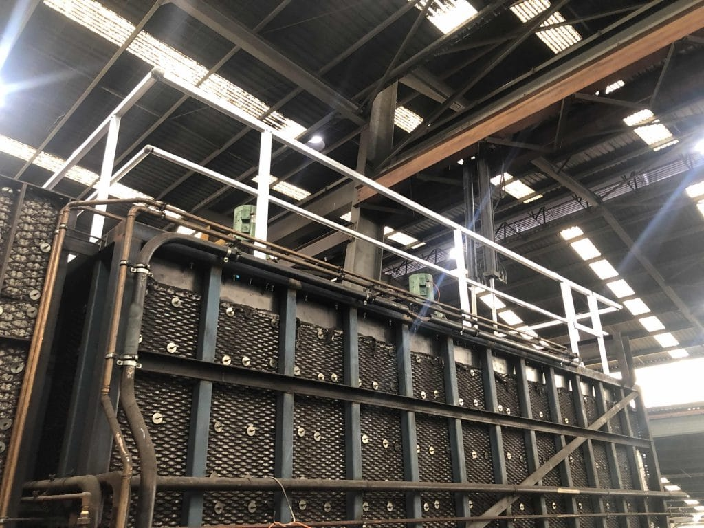 Guardrail fall restraint systems inside a large warehouse/ factory