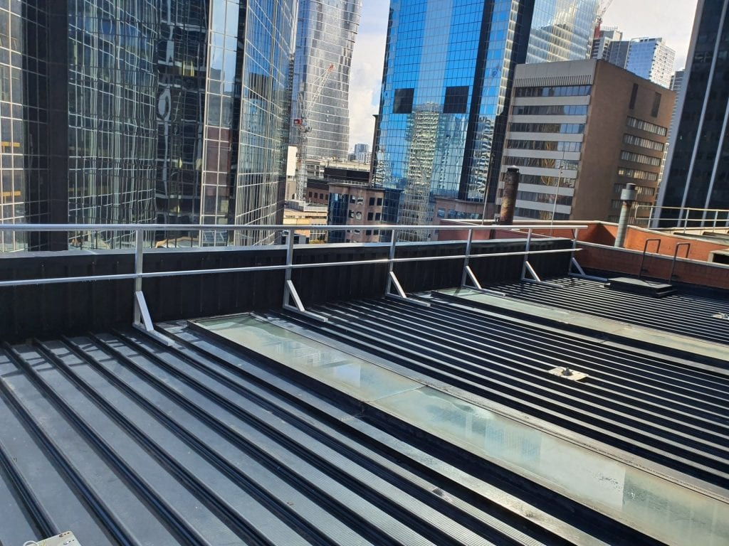 Rooftop guardrail system with skyscrapers in the background