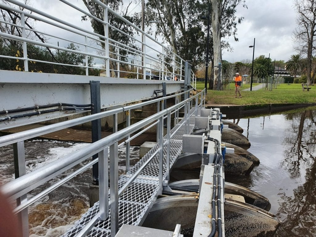 A portable walkway set up along side a bridge to allow maintenance in a safe manner