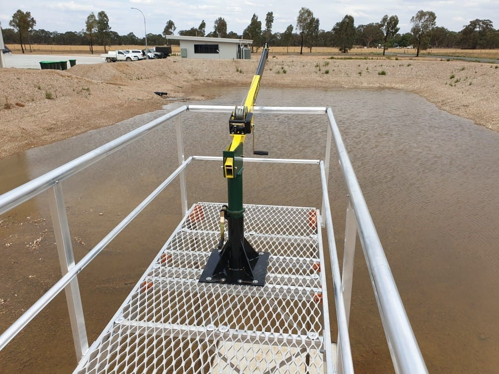 Customized walkway platform with crane and winch over a dam in rural Australia