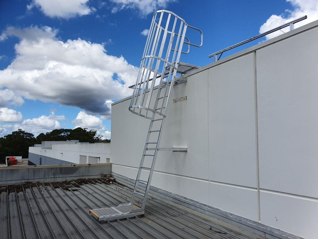 An angled Caged Ladder and Parapet Crossover leading to an upper roof level