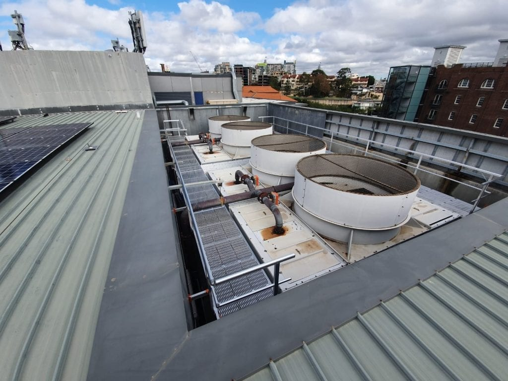Cooling towers with access provided through walkway and guardrail systems