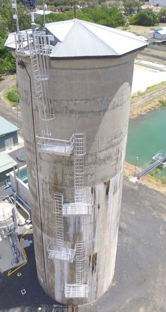 A 4 stage caged ladder system providing access to a large silo