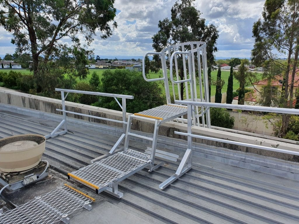 Parapet Crossover with Guardrail system including a caged access ladder, landing platform and guardrails