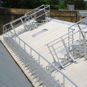 Permenant aluminium roof guardrail and levelled walkway system proving safe and compliant access to rooftop machinery