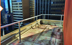 Permenant safety railing installed to protect workers from a fall edge on a Sydney highrise