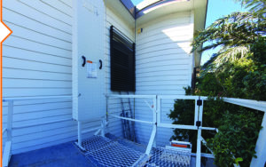Height safety guardrailing with self closing gate, powdercoated white